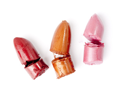 lipstick samples cut on white background