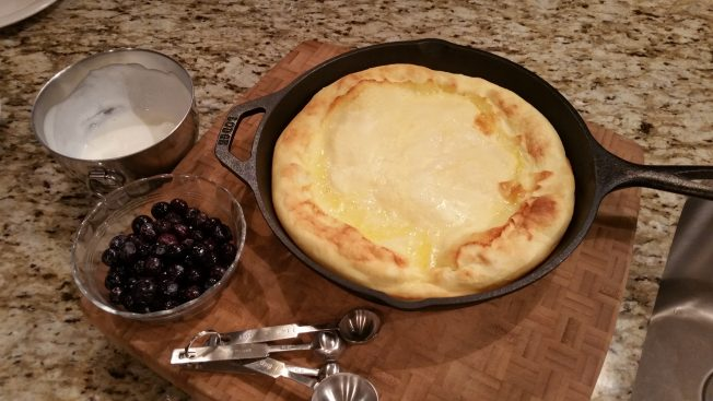 Finished German style pancake right out of the oven, looking perfect.