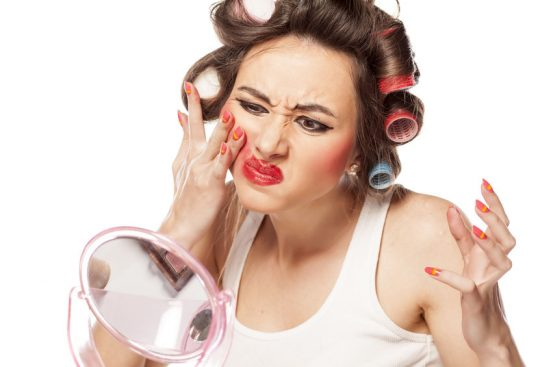 Women trying to remove makeup that won't budge.
